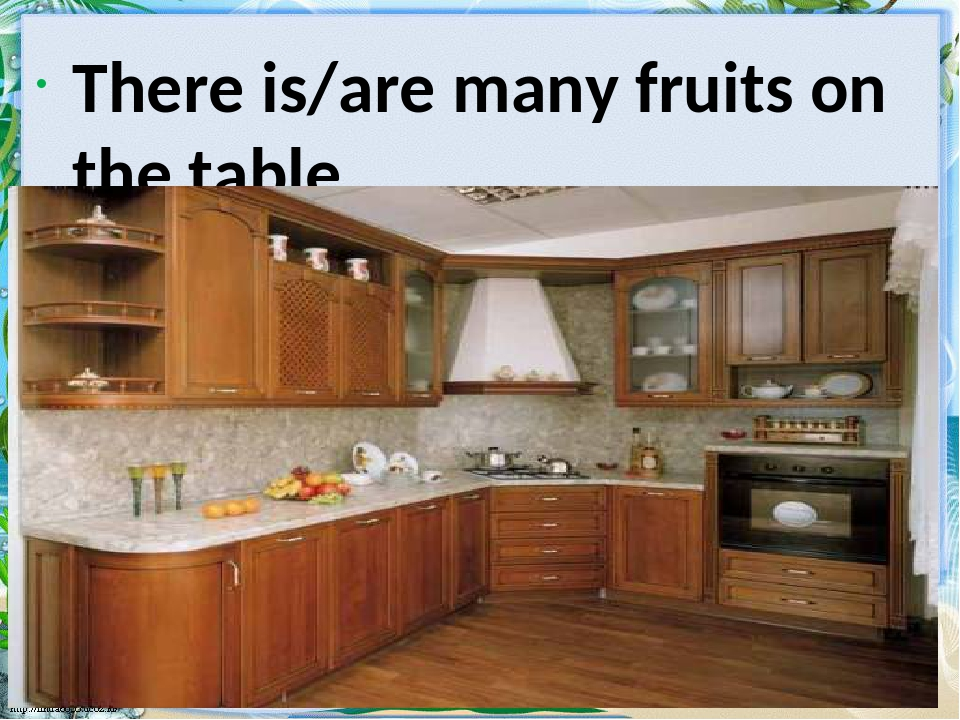 There is/are many fruits on the table.