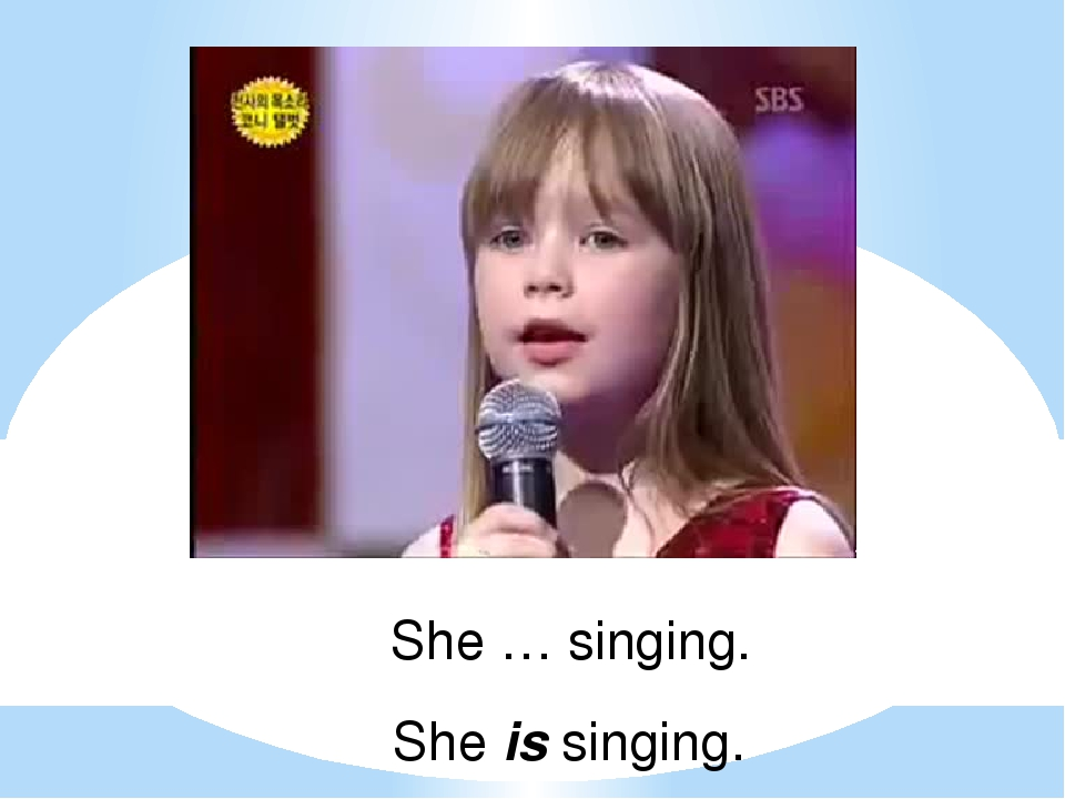 She … singing. She is singing.